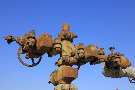 mechanization: Oil pipeline and equipment under the blue sky, closeup of photo Stock Photo