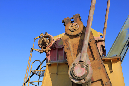 pumping unit: oxidation rust pumping unit parts under blue sky in oilfield