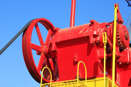 oilfield: wheels on petroleum machinery under blue sky in oilfield Stock Photo