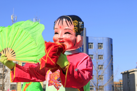folk dance: Chinese traditional style yangko folk dance girl mask in the street, luannan County, hebei Province, China Editorial