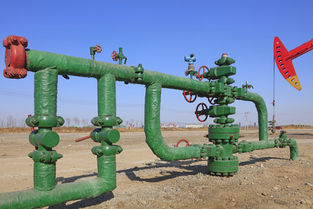 pumping unit: Oil pipeline and pumping unit, closeup of photo Editorial