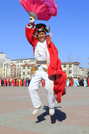 hebei: Luannan County- February 20: Chinese traditional style yangko folk dance performance in the street, on February 20, 2016, luannan County, hebei Province, China Editorial