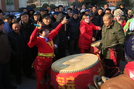 percussionist: Luannan county - February 21: traditional Chinese style yangko percussionist on the square, on February 21, 2016, luannan county, hebei province, China Editorial