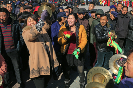 percussionist: Luannan county - February 20: traditional Chinese style yangko percussionist on the square, on February 20, 2016, luannan county, hebei province, China
