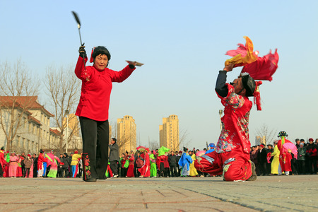Luannan County- February 22: Chinese traditional style yangko folk dance performance in the street, on February 22, 2016, luannan County, hebei Province, China
