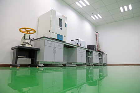 reflective: Laboratory cabinet and clean floor Editorial