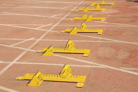 starting blocks: Starting blocks in the plastic on the playground Stock Photo