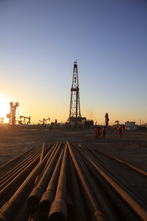 Oil drilling derrick and pipelines in oilfield