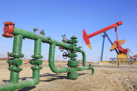 Oil pipeline and pumping unit, closeup of photo Editorial