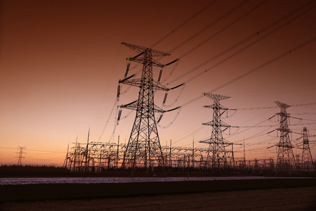 steel tower: high voltage electric power steel tower in the setting sun Stock Photo