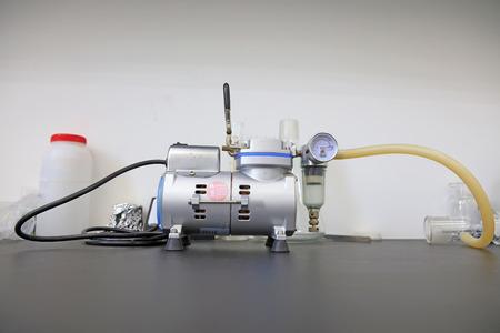 air pump: air pump on the desk, closeup of photo