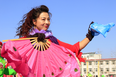 hebei: Luannan County- February 18: Chinese traditional style yangko folk dance performance in the street, on February 18, 2016, luannan County, hebei Province, China Editorial
