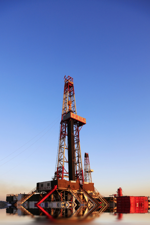 Jidong oilfield - February 8: oil drilling derrick, on February 8, 2016, jidong oilfield, caofeidian, hebei, China Editorial