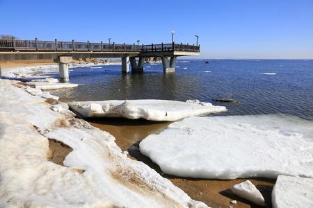 seawater: pier on the seaside in winter, closeup of photo