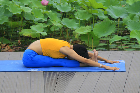 hebei: a woman doing yoga exercise in the park, luannan county, hebei province, China