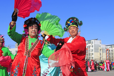 hebei: Luannan County- February 15: Chinese traditional style yangko folk dance performance in the street, on February 15, 2016, luannan County, hebei Province, China Editorial
