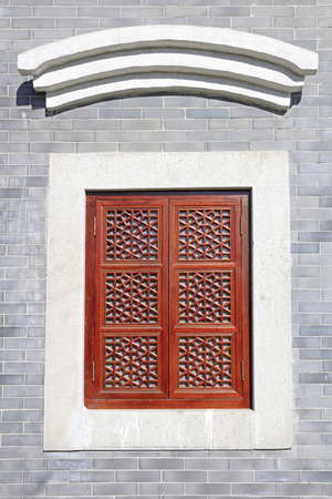 antiquity: Wooden lattice in the gray walls