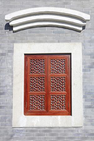 tenon: Wooden lattice in the gray walls
