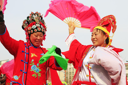 hebei: Luannan County- February 19: Chinese traditional style yangko folk dance performance in the street, on February 19, 2016, luannan County, hebei Province, China