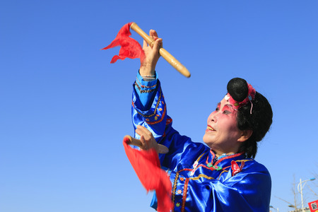 abilities: Luannan County- February 17: Chinese traditional style yangko folk dance performance in the street, on February 17, 2016, luannan County, hebei Province, China Editorial