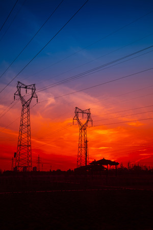 setting  sun: Electric power tower under the setting sun