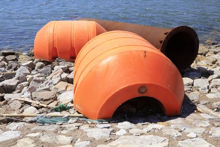 dredging tools: Dredging steel buoy at seaside