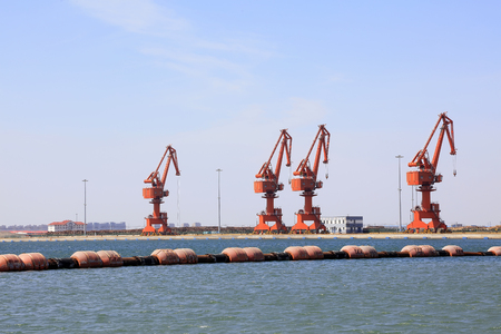 gantry: Dredging buoy and gantry crane in the dock