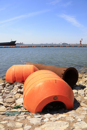 Dredging steel buoy in the dock Stock Photo