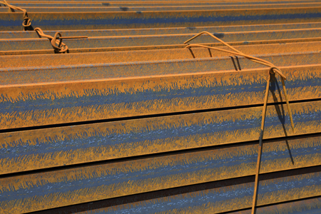 steel plate: steel plate banding piled up together, closeup of photo