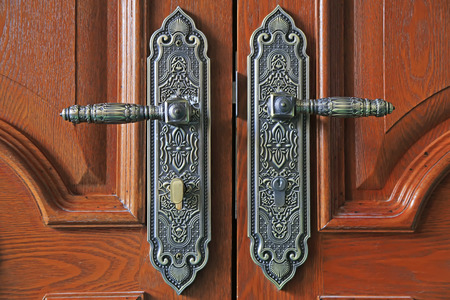 door handle: Wooden door metal handle Stock Photo