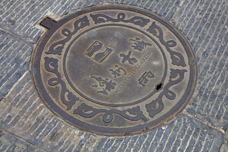 municipal utilities: Tangshan - July 16: rain manhole cover on the road, on July 16, 2016, tangshan city, hebei province, China