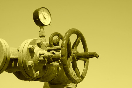 Oil pipe and pressure gauge, closeup of photo