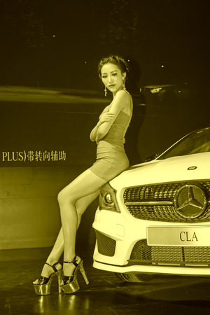 ankles sexy: TANGSHAN - MAY 31: Beauty model in a car markets,on may 31, 2014, Tangshan city, Hebei Province, China Editorial