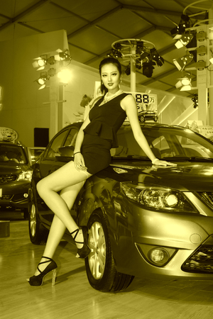 ankles sexy: TANGSHAN - MAY 31: Beauty model in a car market on may 31, 2014, Tangshan city, Hebei Province, China