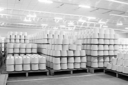 semifinished: cotton group on a spinning production line in a factory Editorial