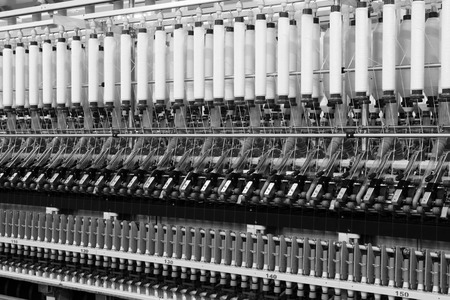 Textile spindles on the production line, closeup of photo Editorial
