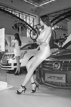 ankles sexy: TANGSHAN - MAY 31: model in a car markets on may 31, 2014, Tangshan city, Hebei Province, China Editorial