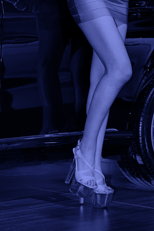 purple shoes: wheels and purple skirt high-heeled shoes in a auto show