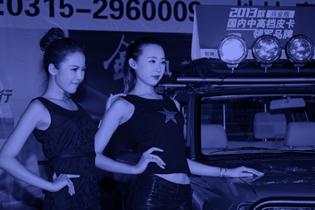 tangshan city: TANGSHAN - MAY 31: Beauty model in a car markets,on may 31, 2014, Tangshan city, Hebei Province, China