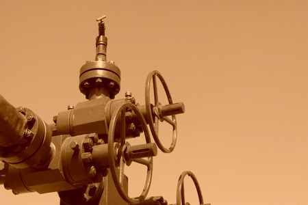 restore ancient ways: green petroleum machinery and red handwheel, closeup of photo Stock Photo
