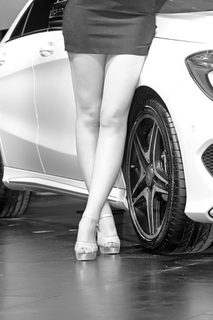 ankles sexy: Cars and high-heeled sandals in a auto show