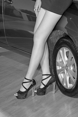 ankles sexy: wheel and sexy high heels, closeup of photo