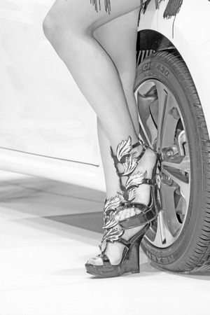ankles sexy: wheels and novel high heels in a auto show Editorial