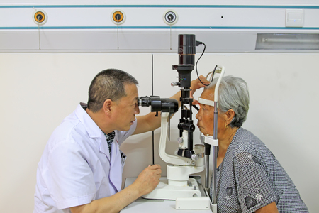 fundus: Luannan County - June 18th: a doctor examining the fundus of patients, June 18th, 2015, Luannan County, Hebei Province, China Editorial