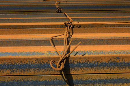 steel plate banding piled up together, closeup of photo