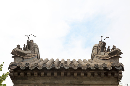 restore: beast sculpture on eaves in temple, China Stock Photo