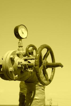 Oil pipe and pressure gauge, closeup of photo