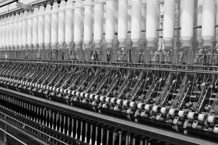 spindles: Textile spindles on the production line, closeup of photo Stock Photo