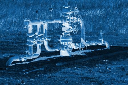 green petroleum machinery and red handwheel, closeup of photo Editorial