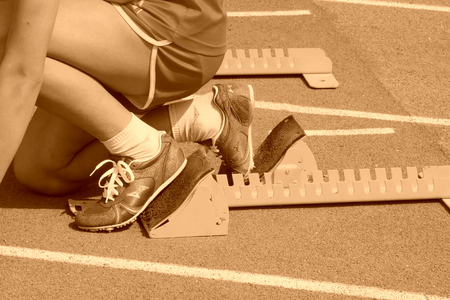debugging: athletes debugging run up ware on plastic runway in a middle school